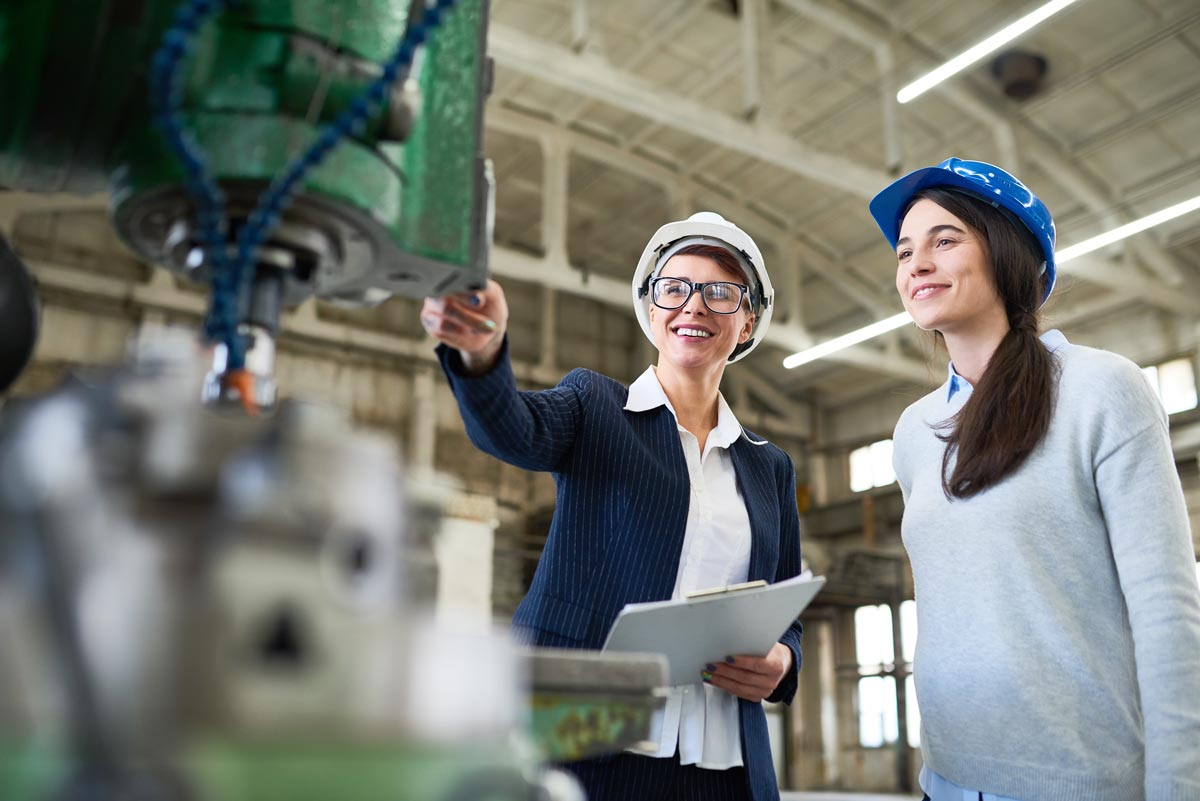 Optimistic inspectors holding examination in factory